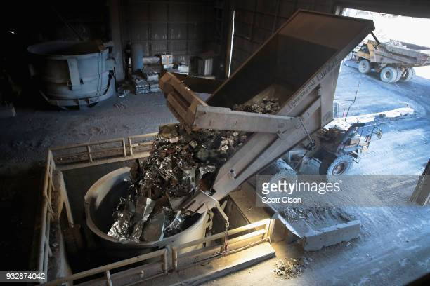 Eighty tons of scrap steel is loaded into a bucket before being melted at 3000 degrees Fahrenheit in an electric arc furnace to produce new steel at...