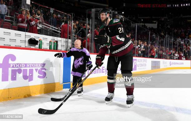 Eightyear old Leighton Accardo who is battling germ cell cancer skates out on to the ice with Oliver EkmanLarsson of the Arizona Coyotes as she is...