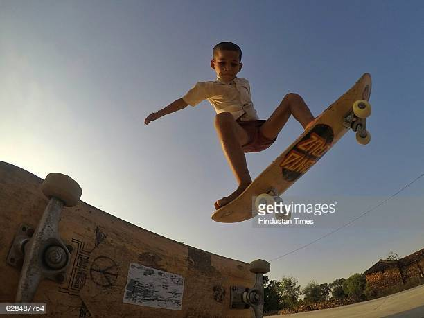 Eight-year-old Ankush skate boarding barefoot at Skating park, popularly known as Janwaar Castle on October 26, 2016 in Janwaar, India. In just six...