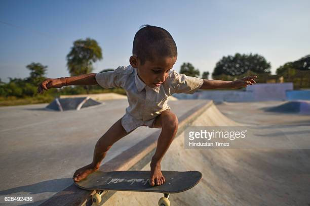 Eight-year-old Ankush skateboarding barefoot at Skating Park, popularly known as Janwaar Castle, on October 26, 2016 in Janwaar, India. In just six...