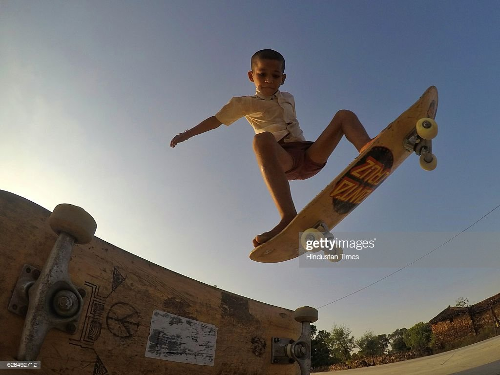 Eight-year-old Ankush skates boarding barefoot at Skating Park, popularly known as Janwaar Castle, on October 26, 2016 in Janwaar, India. In just six months, he has learned almost all the basic moves and stunts of skateboarding. Thanks to a German community activist and author Ulrike Reinhard, skateboarding is slowly changing the children in this Madhya Pradesh village divided by caste. Located along the fringes of the Panna National Tiger Reserve, the Janwaar Skating Park is a not-for-profit project that teaches village children skateboarding free of cost. The park is a place for unfettered fun, but has two strict ground rules. Rule number one: Girls first. And rule number two: No school, no skateboarding. The park also bridges caste disparities by bringing together the village Adivasi and upper caste Yadav and Kushwaha children to play together.
