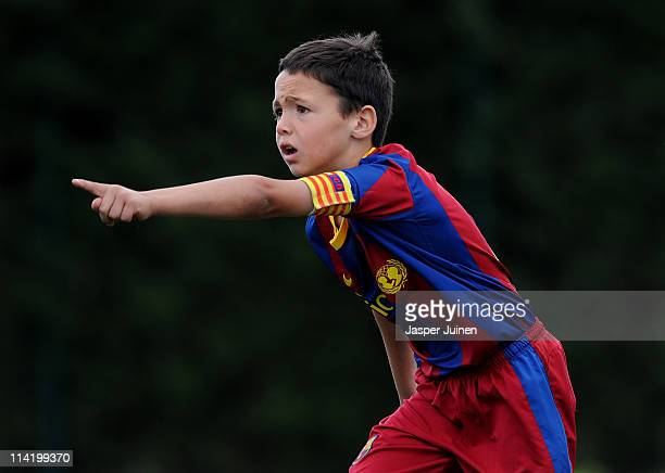 Eightyearold Barcelona youth player Arnau Martinez celebrates scoring against Llongueras on one of the pitches at the Joan Camper training ground on...