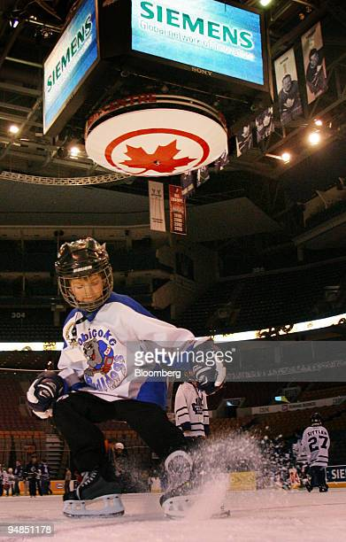 Eightyearold Jacob Evans skates under the Air Canada Centre's scoreboard with the Roundel promoting Air Canada during a fundraising charity skate...