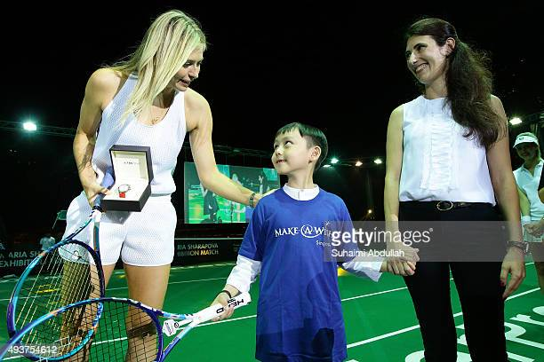 Eight-year-old Joshua Ong , who suffers from non-Hodgkin lymphoma presents a TAG Heuer limited edition SG50 AquaracerÊto Maria Sharapova as Amelia...