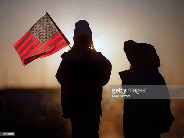 Eightyearold Julie Jackson and her sister threeyearold Melissa Jackson of Norfolk VA brave the early morning cold as they wait for the arrival of...