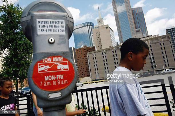 Eight-year-old Marshal Gordon walks to a soup kitchen for lunch on June 17, 2009 in Dallas, Texas. Marshal currently lives with his parents at the...