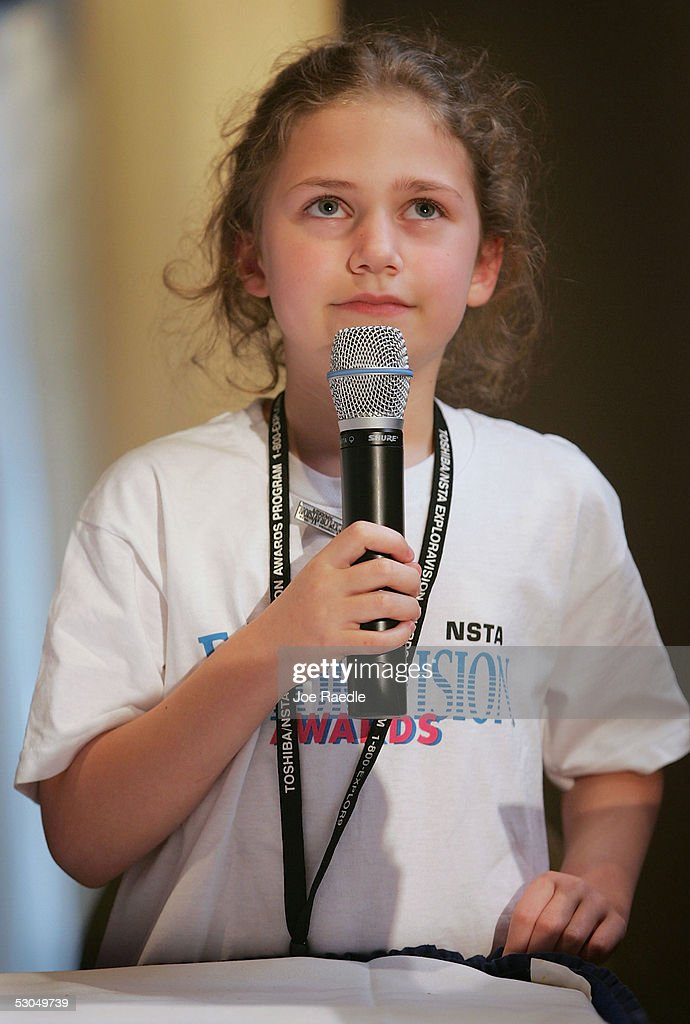 Eight-year-old Rebekah Blatt, of Dardenne Elementary School in O'Fallon, MO, tries to remember the speech she memorized for the Toshiba NSTA ElxploraVision Awards luncheon during the presentation of 'Living Impaired Future Eye' technology that her team invented June 10, 2005 in Washington, DC. The L.I.F.E. technology allows visually impaired people to use a hands-free unit that uses an infrared motion system and ultrasound to detect and communicate movement to the user, allowing blind people to walk without a cane. The awards competition is one of the world's largest K-12 science and technology competitions in which teams of students envision technologies that could exist 20 years in the future.