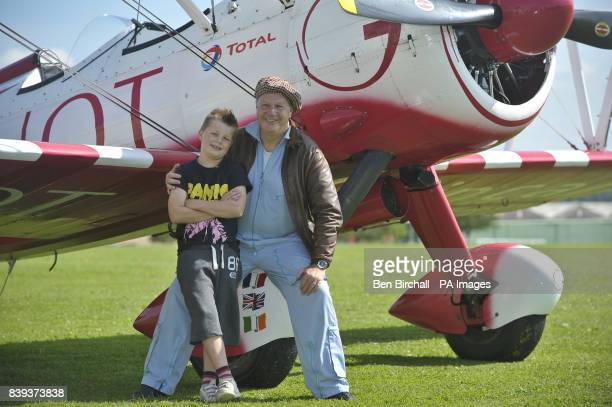 Eightyearold Tiger Brewer sits with his grandad Vic Norman prior to wingwalking on his grandfather's biplane and into the record books as he became...