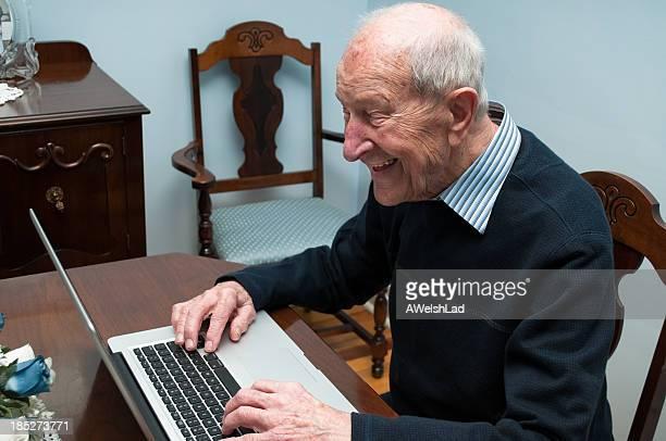 Eighty-eight year old senior man enjoying his laptop computer