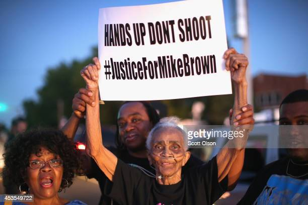 Eightyeightyearold Creola McCalister joins other demonstrators protesting the killing of teenager Michael Brown outside Greater St Marks Family...