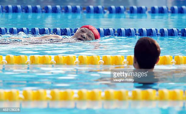 Eightyeightyearold Toshiko Amano of Japan is watched closely by a lifeguard as she struggles to complete the Women's 800m Freestyle at Parc...