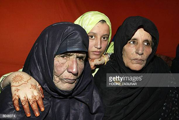 Eightyfiveyearold Edjemaia bent El Hafedh poses with her 56yearold daughter Echehaiba and her 20yearold grandaughter Aziza after the family was...