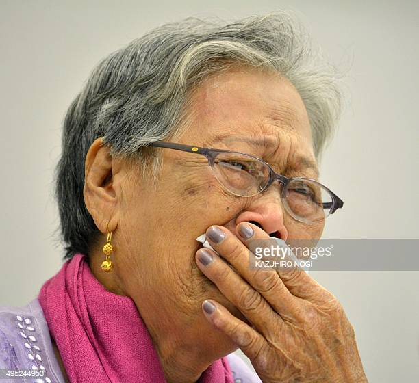 Eightyfouryearold Estelita Basbano Dy of the Philippines reacts as she speaks during a meeting as part of the 12th Asian Solidarity Conference for...