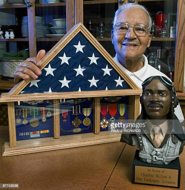 Eightynine yearold Charles E McGee Colonel USAF Retone of the famed Tuskegee Airmen sits with some of his US Air Force medals and duty ribbons at his...