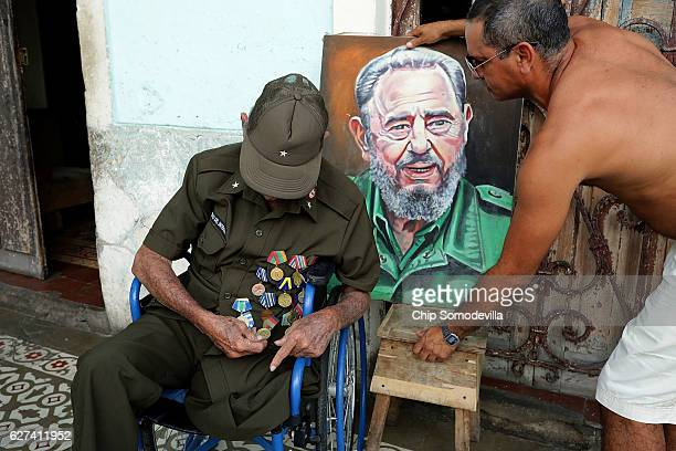 Eightysevenyearold Don Altilo Boijoli a personal chauffer to former Cuban President Fidel Castro during the early 1960s displays his medals as his...