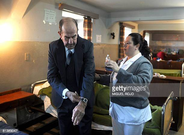 Eightytwoyearold Alfredo Maciel gets dressed for his wedding to seventysevenyearold Nilsa Noble at the public geriatric hospital Pieyro del Campo in...