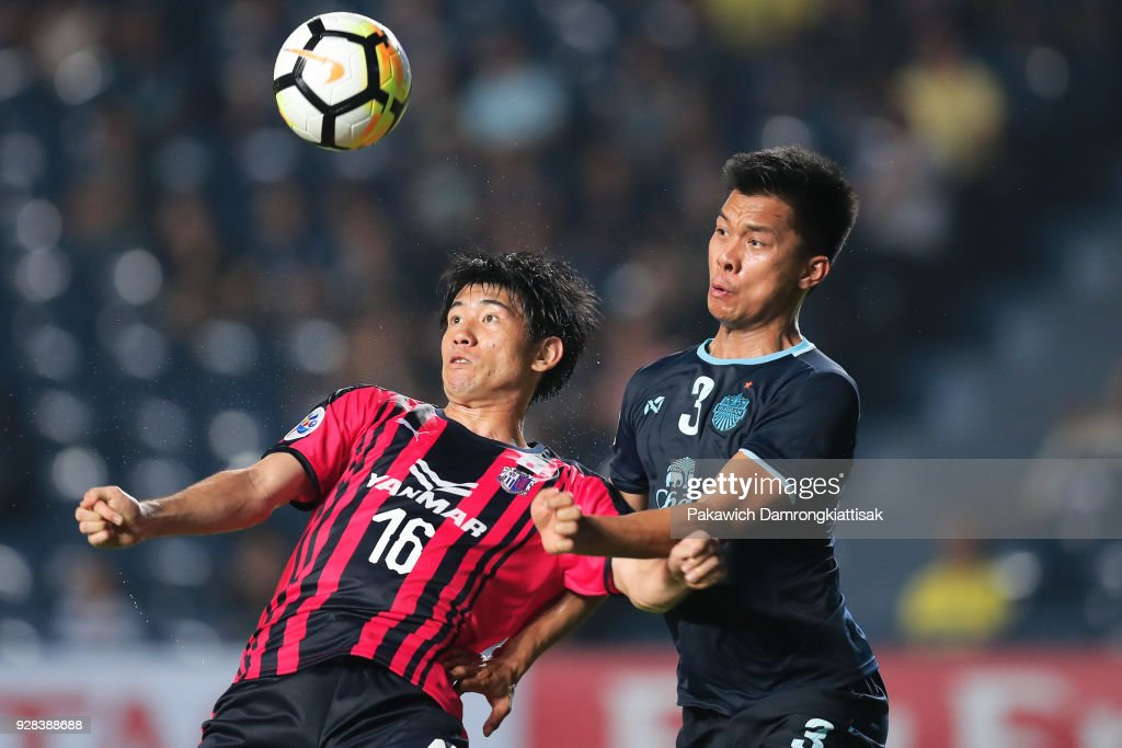 Eiichi Katayama #16 of Cerezo Osaka (L) and Pansa Hemviboon #3 of Buriram United FC (R) fights for the ball during the AFC Champions League Group G match between Buriram United Football Club and Cerezo Osaka at Thunder Castle on March 6, 2018 in Buriram, Thailand.
