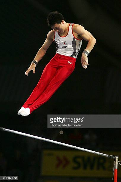 Eiichi Sekiguchi of Japan performs at the high bar competition during the 2006 International Gymnastics DTB Cup at the Schleyer Hall on October 29...