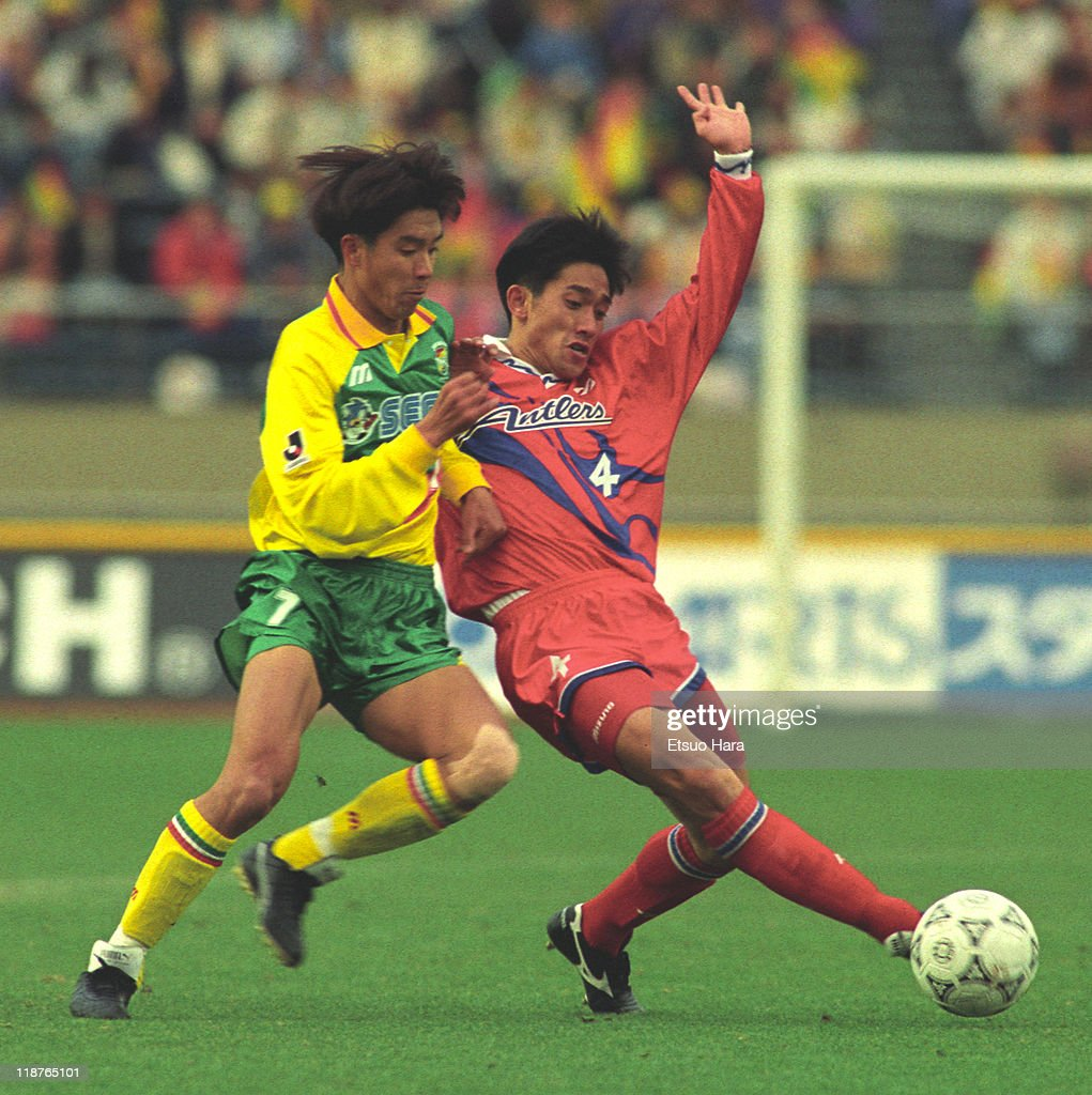 Eiji Gaya of Kashima Antlers and Atsuhiko Ejiri of JEF United Ichihara compete for the ball during the J.League Suntory Series match between JEF United Ichihara and Kashima Antlers at the National Stadium on March 26, 1994 in Tokyo, Japan.