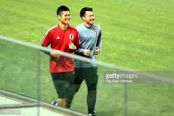 Eiji Kawashima and Shinji Okazaki of Japan warm up during a training session on June 21 2019 in Belo Horizonte Brazil