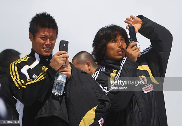 Eiji Kawashima and Yuji Nakazawa takes pictures of the view during a visit by members of the Japan football team to Allalin on June 2, 2010 in...