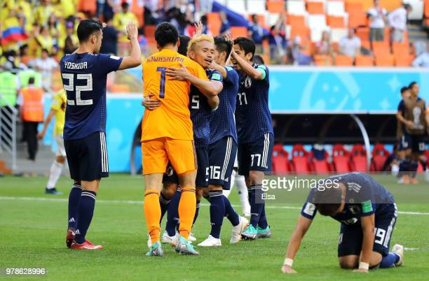Eiji Kawashima and Yuto Nagatomo of Japan celebrate after winning the 2018 FIFA World Cup Russia group H match between Colombia and Japan at Mordovia...