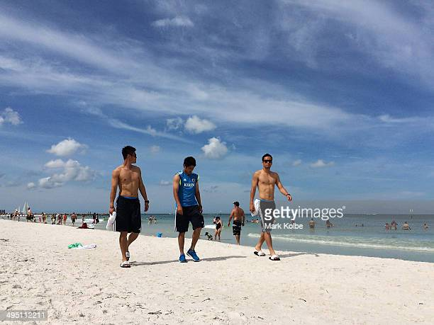 Eiji Kawashima, Atsuto Uchida and Maya Yoshida of Japan walk along Clearwater beach on June 1, 2014 in Clearwater, Florida.