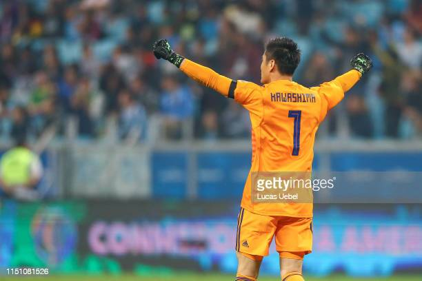 Eiji Kawashima goalkeeper of Japan celebrates his team's first goal during the Copa America Brazil 2019 group C match between Uruguay and Japan at...