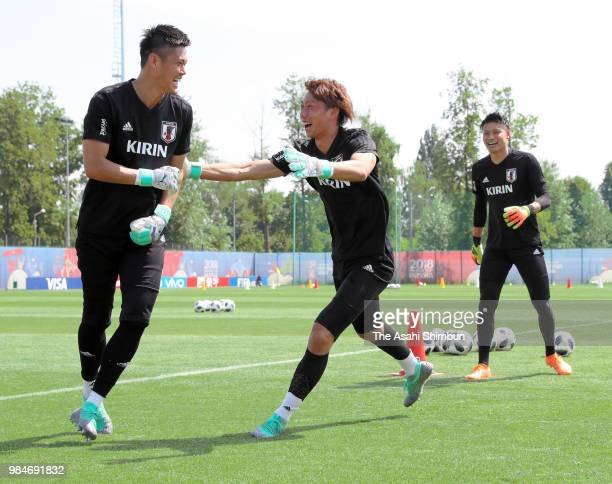 Eiji Kawashima Masaaki Higashiguchi and Kosuke Nakamura of Japan share a laugh during the Japan training session on June 26 2018 in Kazan Russia