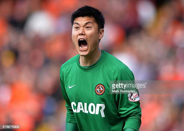 Eiji Kawashima of Dundee United gestures to his team mates during the Ladbrokes Scottish Premiership match between Dundee United FC and Dundee FC at...
