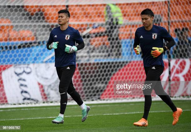 Eiji Kawashima of Japan and Kosuke Nakamura of Japan warm up during a Japan training session ahead of the FIFA World Cup Group H match between Japan...