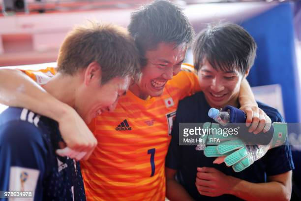 Eiji Kawashima of Japan celerbates with teammates following his sides victory in the 2018 FIFA World Cup Russia group H match between Colombia and...