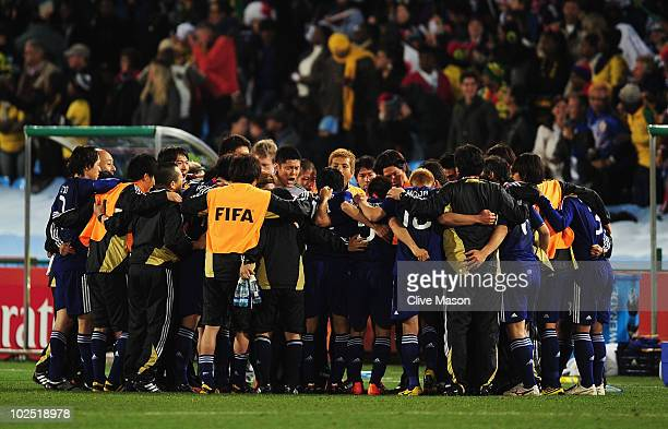 Eiji Kawashima of Japan conducts a team talk as the teams play into extra time during the 2010 FIFA World Cup South Africa Round of Sixteen match...