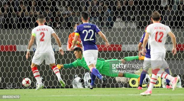 Eiji Kawashima of Japan dives in vain as Mardik Mardikian of Syria scores the opening goal during the international friendly match between Japan and...