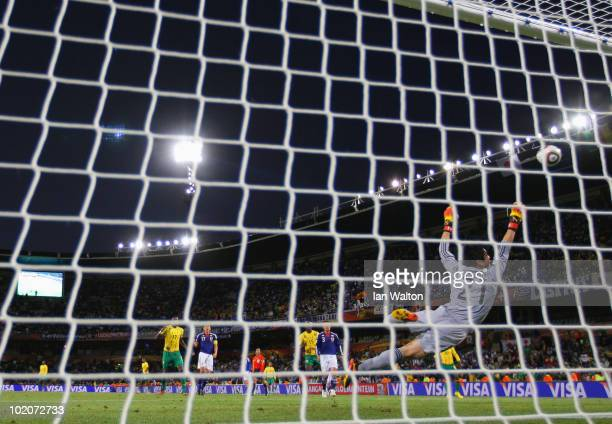 Eiji Kawashima of Japan dives to save a shot on goal during the 2010 FIFA World Cup South Africa Group E match between Japan and Cameroon at the Free...