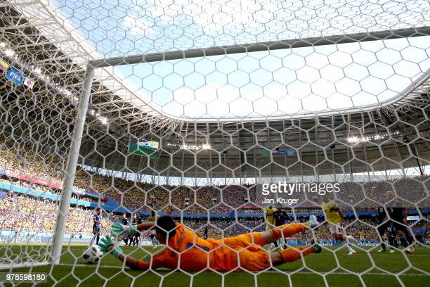 Eiji Kawashima of Japan fails to save on the line as Juan Quintero of Colombia scores the first Colombia goal during the 2018 FIFA World Cup Russia...