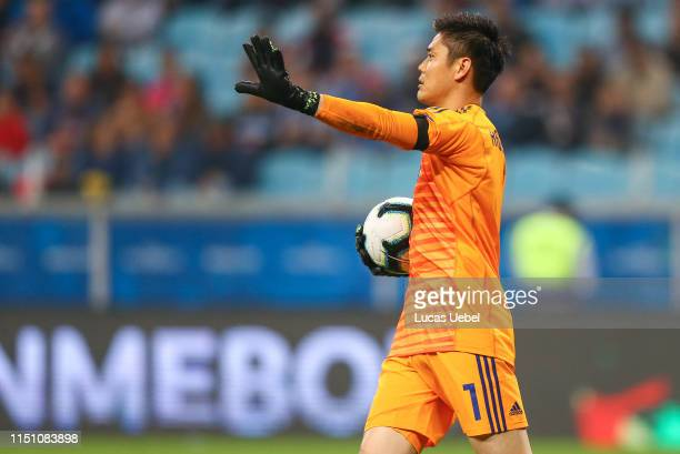 Eiji Kawashima of Japan holds the ball during the Copa America Brazil 2019 group C match between Uruguay and Japan at Arena do Gremio on June 20 in...