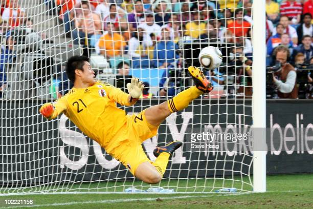 Eiji Kawashima of Japan looks on as a shot from Wesley Sneijder of the Netherlands hits the back of the net during the 2010 FIFA World Cup South...