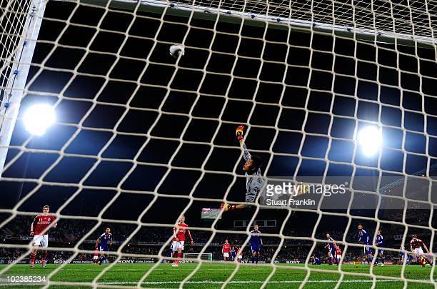 Eiji Kawashima of Japan makes a save during the 2010 FIFA World Cup South Africa Group E match between Denmark and Japan at the Royal Bafokeng...