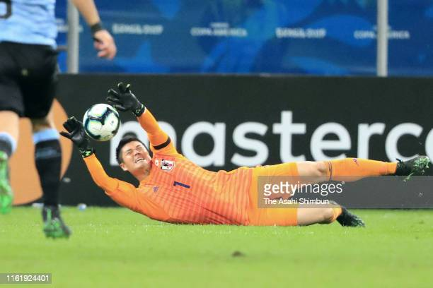 Eiji Kawashima of Japan makes a save during the Copa America Brazil 2019 group C match between Uruguay and Japan at Arena do Gremio on June 20 2019...