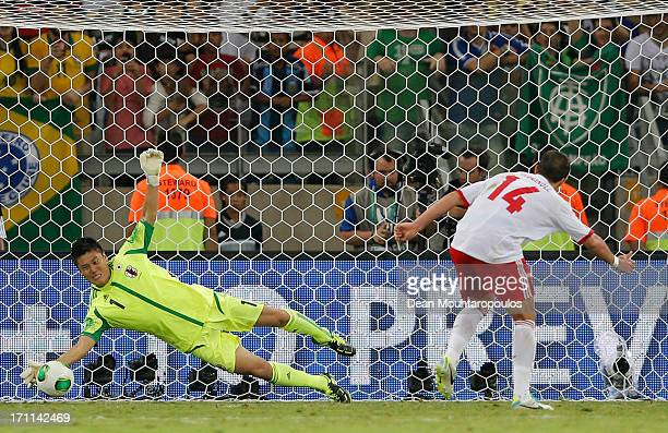 Eiji Kawashima of Japan makes a save on the penalty kick of Javier Hernandez of Mexico during the FIFA Confederations Cup Brazil 2013 Group A match...