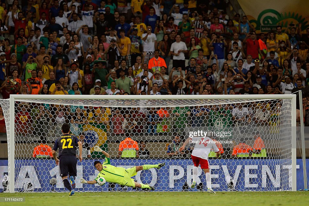 Eiji Kawashima of Japan makes a save on the penalty kick of Javier Hernandez of Mexico during the FIFA Confederations Cup Brazil 2013 Group A match between Japan and Mexico at Estadio Mineirao on June 22, 2013 in Belo Horizonte, Brazil.