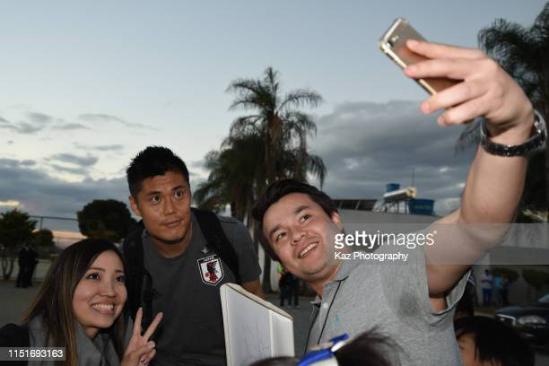 Eiji Kawashima of Japan poses for a selfie with Japanese Brasilians during the training session on June 22 2019 in Belo Horizonte Brazil