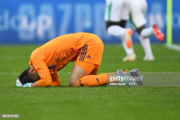 Eiji Kawashima of Japan reacts after conceding the first goal to Japan during the 2018 FIFA World Cup Russia group H match between Japan and Senegal...