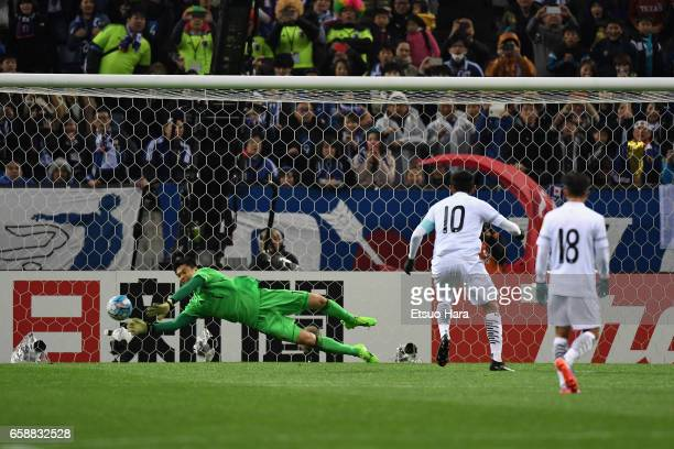 Eiji Kawashima of Japan saves the penalty kick by Teerasil Dangda of Thailand during the 2018 FIFA World Cup Qualifier match between Japan and...