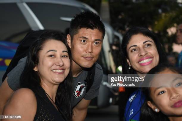 Eiji Kawashima poses for a selfie with Japanese Brasilians during the training session on June 22 2019 in Belo Horizonte Brazil