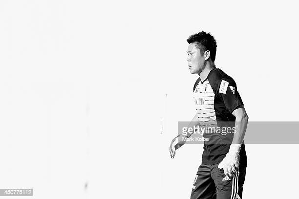 Eiji Kawashima watches on during a Japan training session at the Japan national team base camp at the Spa Sport Resort on June 17 2014 in Itu Sao...