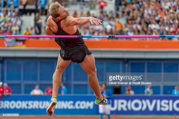 Eike Onnen of Germany climbing up during the men's high jump finals at the Olympic Stadium during Day Five of the 23rd European Athletics...