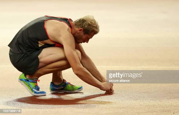 Eike Onnen of Germany prepares the track during the Men's High Jump final at the 15th International Association of Athletics Federations Athletics...