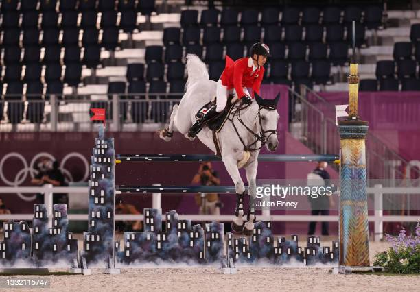 Eiken Sato of Team Japan riding Saphyr Des Lacs competes during the Jumping Individual Qualifier on day eleven of the Tokyo 2020 Olympic Games at...